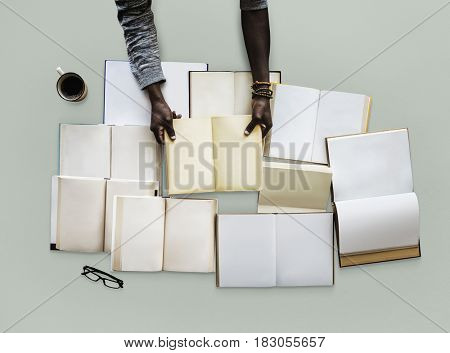 Hand with a empty book collection