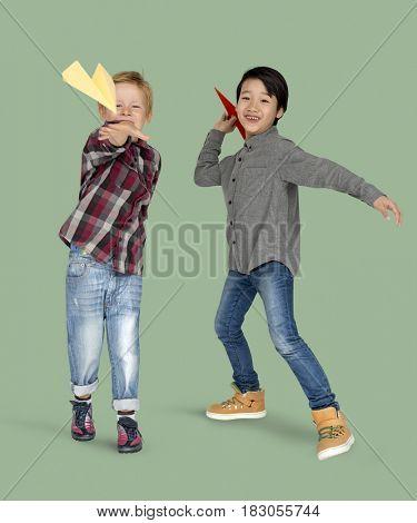 Little Boys Holding Paper Plane Studio Portrait