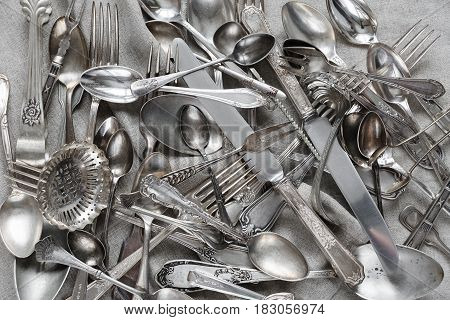 Various silverware on a background of gray linen fabric