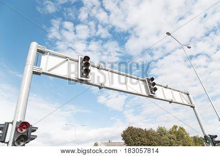 Double semaphore over a blue cloudy sky