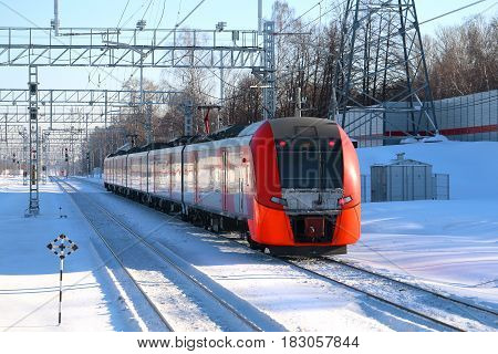 Landscape photos of the train arriving to the station on a winter afternoon
