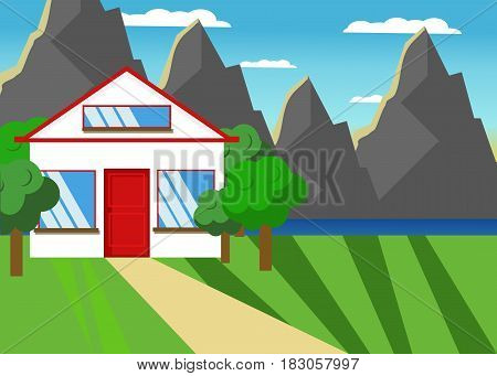 House in the countryside. White house with trees around and mountains on the background.