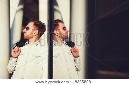Handsome man posing in shirt and glasses