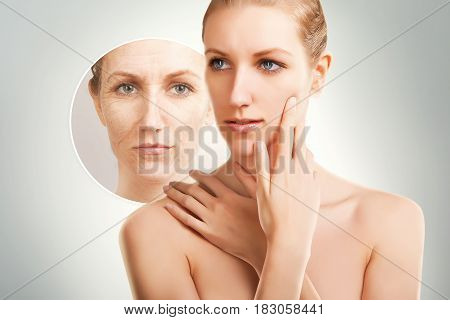age changes on woman`face, grey gradient background