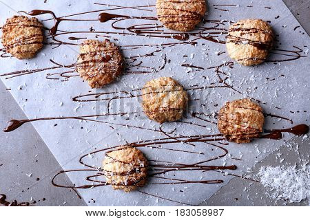 Delicious coconut macaroons on parchment paper