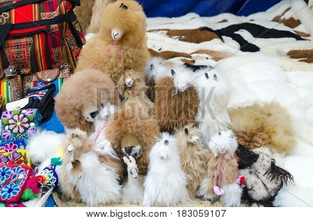 PISAC PERU 10 FEBRUARY 2017: alpaca and lion toys at the market