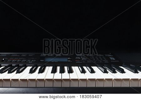 Keys of the electronic synth on a black background
