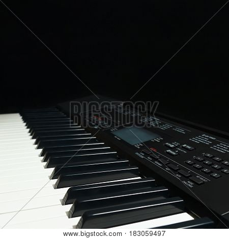 Keyboard of the electronic synthesizer on a black background