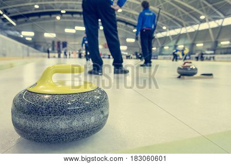 Curling stone on a game sheet. Indoor sport on ice.