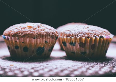 Cupcake and table, selective focus, close up