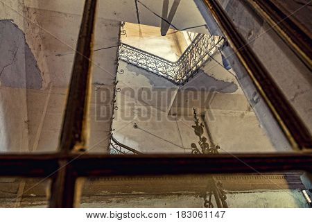 Run-down, dilapidated, musty stairwell detail, photographed outside
