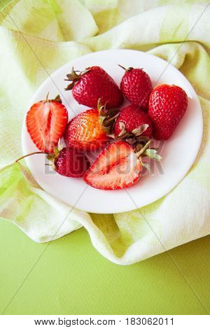 strawberry season: fresh berries on plate, green napkin