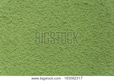Texture of wall plaster repainted in green