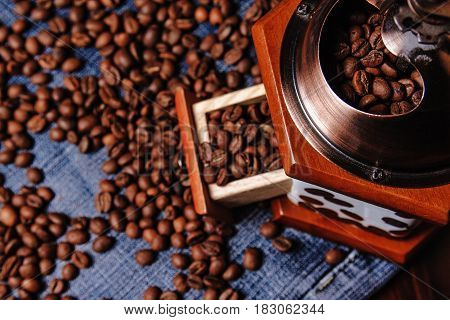 Old Coffee grinder and black coffee beans