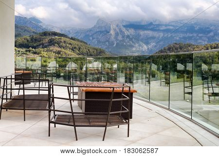 Balcony overlooking the mountains with clouds landscape