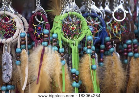 Colorful handmade dreamcatchers on a market close up