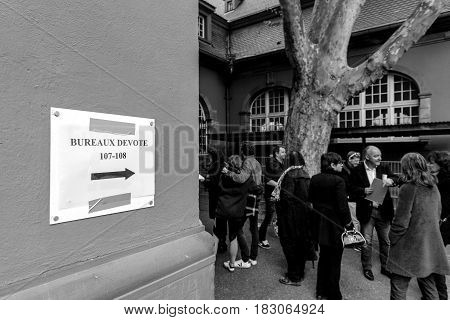 STRASBOURG FRANCE - APR 23 2017: Bureaux de Vote Voting section sign and people silhouettes queue to vote in the first round of the French presidential election in the city of Strasbourg France Alsace