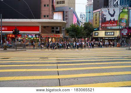 HONG KONG - CIRCA NOVEMBER, 2016: crowd of people waiting to cross a street in Hong Kong.