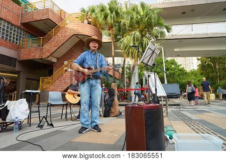 HONG KONG - CIRCA NOVEMBER, 2016: man play guitar at New Town Plaza shopping mall