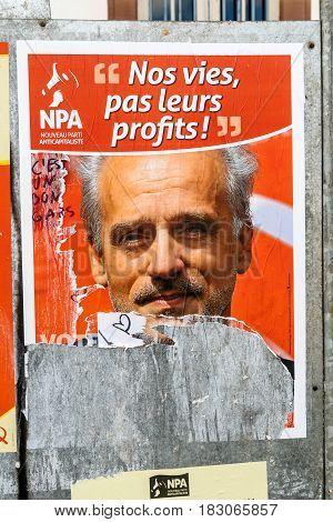 STRASBOURG FRANCE - APR 23 2017: Official campaign posters of Philippe Poutou political party leader of Nouveau Parti anticapitaliste (NPA)