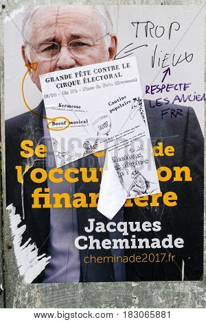 STRASBOURG FRANCE - APR 26 2017: Official campaign posters of Jacques Cheminade political party leader of Solidarité et progres (SP) vandalized on the first round of 2017 French presidential election