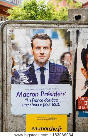 STRASBOURG FRANCE - APR 23 2017: Official campaign posters of Emmanuel Macron political party leader of En marche ! (EM !) on the first round of 2017 French presidential election