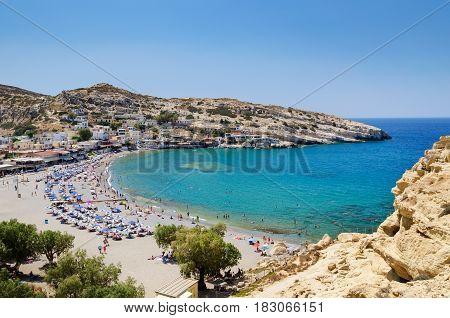 Blue lagoon with sandy beach of Matala town on Crete island, Greece
