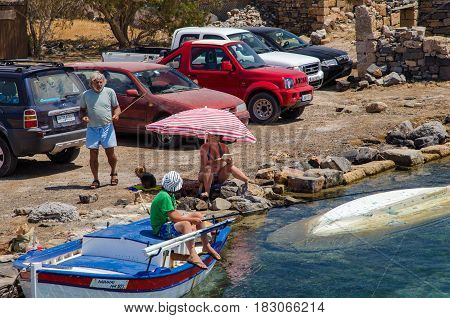 AGHIOS NIKOLAOS, CRETE, GREECE - AUGUST 2016: Greek family is having vacation at coast of Crete island.