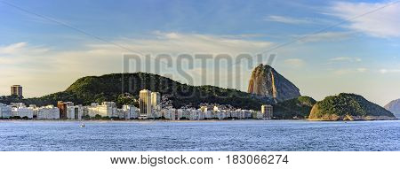 Panoramic image of Copacabana Beach in Rio de Janeiro with its buildings sea sand and the Sugar Loaf hill in the background