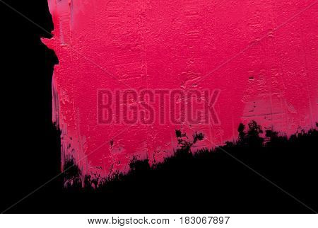 Smear of pink lipstick on a black isolated background