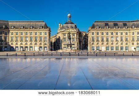 Famous water mirror fountain in front of Place de la Bourse in Bordeaux - France, Aquitaine