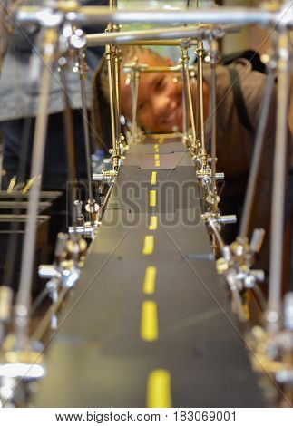 Young African American girl building a bridge with erector set