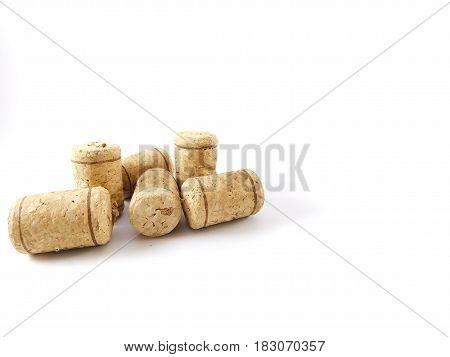 Six corks of bottles together and scattered.