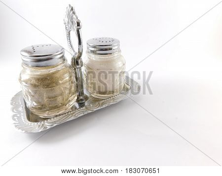 Jar for glass condiments on a silver base.