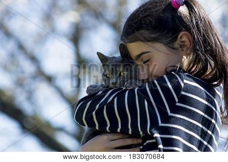 girl holding a cat in her arms love of animals