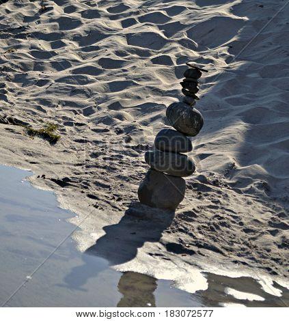 Meditative Rocks Balancing with Reflection in Water