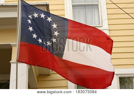 Red, white, and blue flag with 13 stars representing the original thirteen colonies in the usa