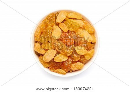 Bowl of golden raisins isolated on white background. Top view