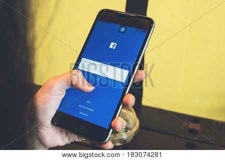 BANGKOK THAILAND - April 24, 2017 : Login Screen Facebook icons on Apple IPhone. largest and most popular social networking site in the world.
