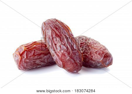 Three dried date-fruit isolated on white background