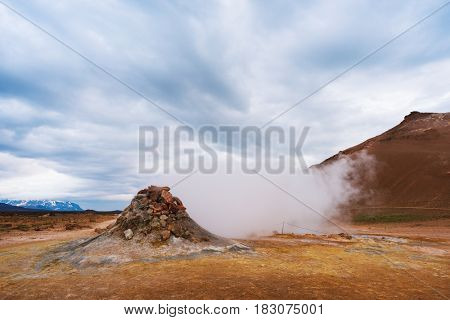 Landscape with eruption steam. Geothermal area Namafjall, Iceland, Europe. Overcast day