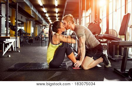 Kiss from fitness partner as prize for well done exercise
