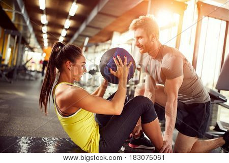 Female exercise abs in fitness center