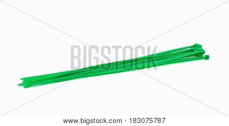 Cable ties green closeup on white background.