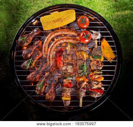 Barbecue garden grill with tasty skewers, close-up.