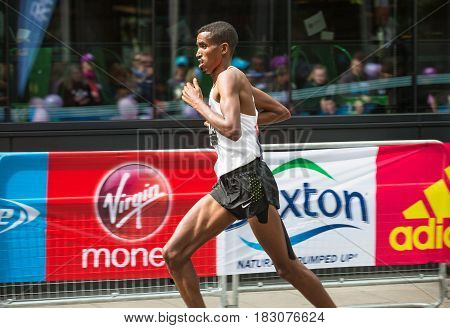 London, UK - April 23, 2017: London Marathon. Professional sprinter arriving the first in Canary Wharf.