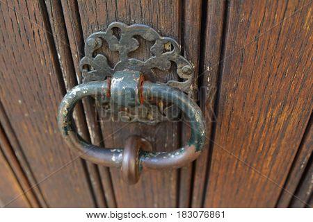 handle door rusty iron ring in wood doorway