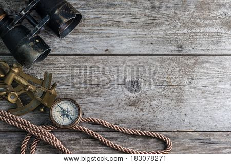 vintage still life with compass,sextant and spyglass. background with copy space ,top view