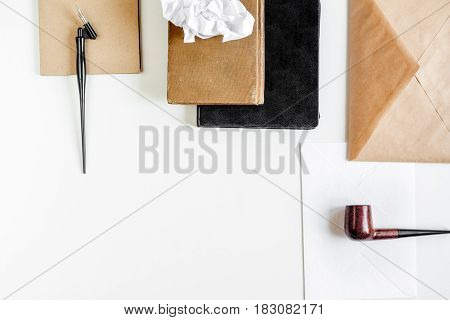 professional writer workplace with tools and pipe on white desk background top view mockup