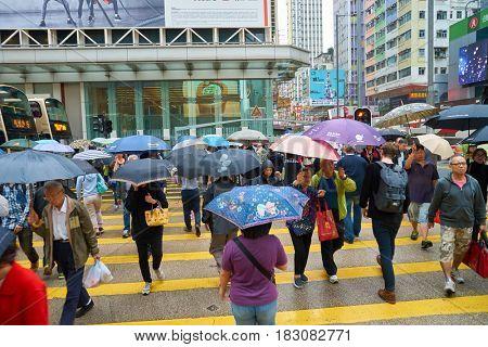 HONG KONG - CIRCA NOVEMBER, 2016: people walking on Hong Kong street at rainy day